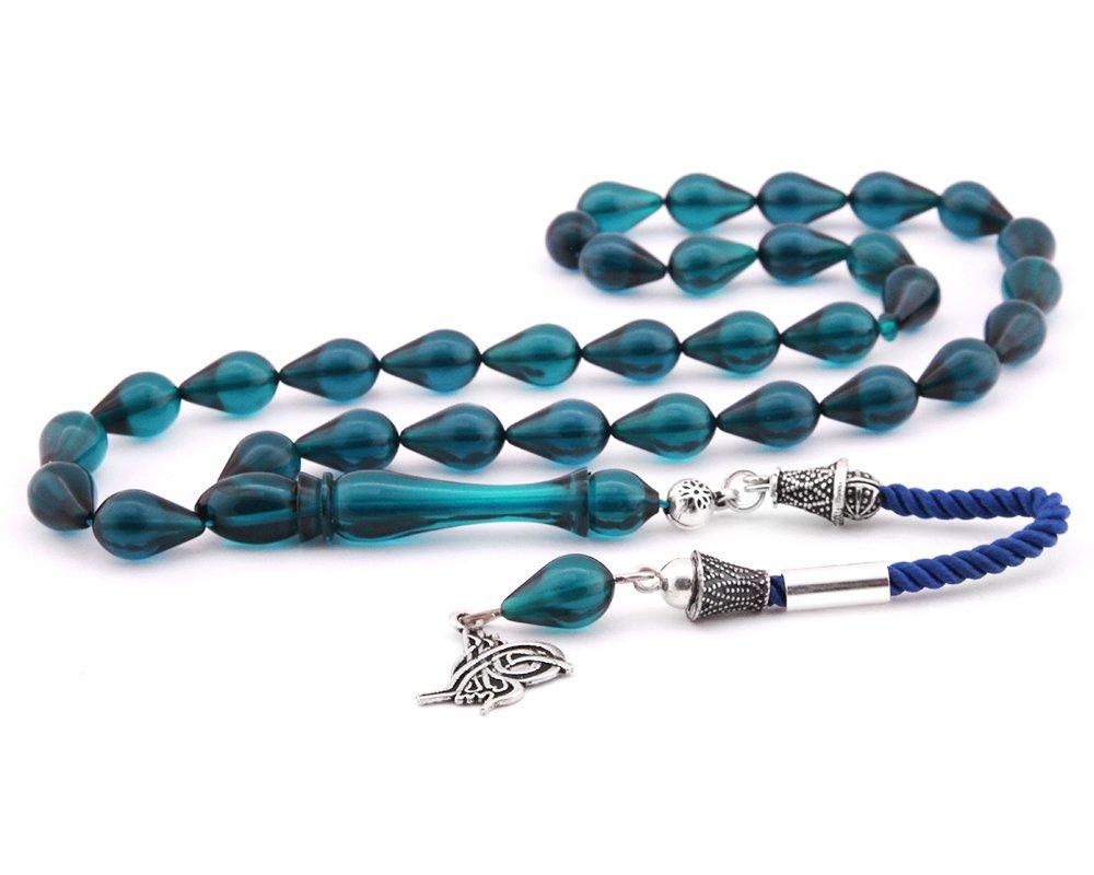925 Ayar Gümüş Tuğra Püsküllü Damla Kesim Mavi Sıkma Kehribar Tesbih